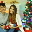 Love couple sitting with mugs — Stok fotoğraf #55645041