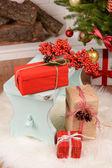 Christmas composition near fireplace — Stock Photo