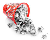 Money in dustbin isolated on white — Stock Photo