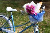 Bicycle with flowers and bottle of wine — Stock Photo
