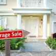 Garage sale sign in front of house — Stock Photo #55733343