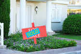 Sold home for sale real estate sign and beautiful new house — Stock Photo