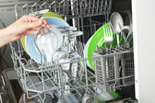 Open dishwasher with utensils — Fotografia Stock