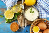 Mayonnaise ingredients on wooden background — Stock Photo