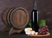 Camembert cheese, wine and grapes — Stock Photo