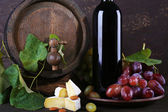 Wine in bottle, Camembert cheese, grapes — Stock Photo