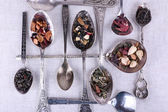 Tea in metal spoons — Stock Photo