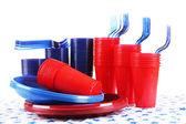 Bright plastic disposable tableware — Stock Photo