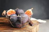Ripe sweet figs in metal basket — Stock Photo