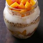 Yogurt with fresh peach and muesli — Stock Photo #55763313