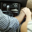 Loving couple holding hands in car close-up — Stock Photo #55907359