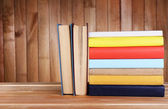 Books on wooden table — Stock Photo