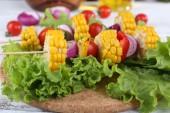 Vegetables on picks on board — Stock Photo