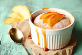 Tasty mini cake with fresh peach, on wooden table — Stock Photo