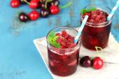 Closeup of cherry granita in glasses, on color wooden background — Stock Photo