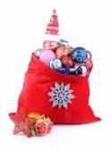 红色的包上白色孤立的圣诞玩具 — 图库照片