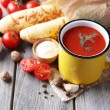 Tomato juice in color mug, bread sticks, spices and fresh tomatoes — Stock Photo #56046519
