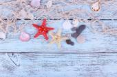 Decor of seashells and seastar close-up on blue wooden table — Stock Photo