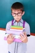 Schoolboy at blackboard in classroom — Stock Photo