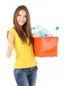 Young girl sorting plastic bottles isolated on white — Stock Photo