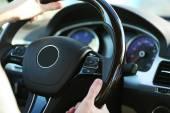 Man's hands on a steering wheel — Stockfoto