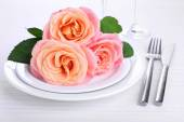 Table setting with pink rose on plate — Stock Photo