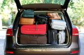 Suitcases and bags in trunk — Stock Photo