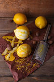 Lemons with nutmegs and grater — Stock Photo