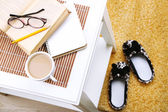 Cup of coffee with book and glasses — Stock Photo