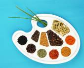 Painting palette with various spices and herbs — Stock Photo