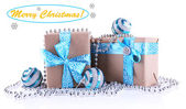Holiday gift boxes with blue ribbon — Stock Photo