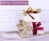 Holiday gift boxes with ribbon on table — Stock Photo