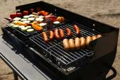 Sausages and vegetables on barbecue — Foto de Stock