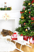 Christmas tree near fireplace — Stock Photo