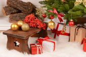 Christmas composition near fireplace — Stock Photo