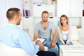 Unhappy couple not talking on couch at therapy session — Stock Photo