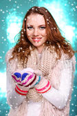Portrait of woman in scarf and gloves on bright blue background — Stock Photo