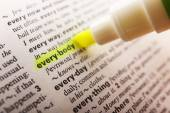 Yellow marker highlighting word in dictionary — Stock Photo
