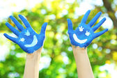 Smiling colorful hands on natural background — Стоковое фото