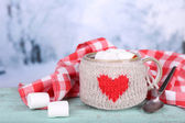 Cup of tasty hot cocoa, on wooden table, on light background — Стоковое фото