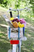 Bicycle with flowers and bread — Stock Photo