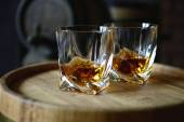 Glasses of brandy in cellar — Stock Photo