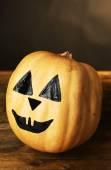 Halloween pumpkin on wooden table — Stock Photo