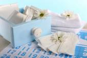 Sanitary pads and white flowers — Stock Photo