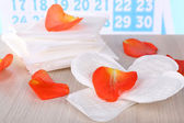 Sanitary pads and rose petals — Stock Photo