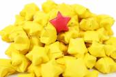 Individuality concept. Origami stars group, close-up — Stock Photo