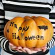 Girl with Halloween pumpkin — Stock Photo #56143559