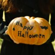 Girl with Halloween pumpkin — Stock Photo #56143727
