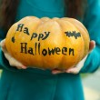 Girl with Halloween pumpkin — Stock Photo #56143753