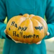 Girl with Halloween pumpkin — Stock Photo #56143765